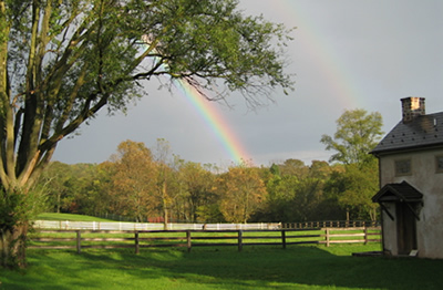 farm with two rainbows